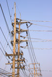 Power lines, electric transmission towers. Electrical transmission lines for electricity use in the home Stock Image