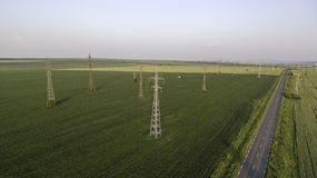 Power lines on the field. Areal view day time Royalty Free Stock Image
