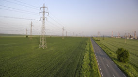 Power lines on the field. Areal view day time Royalty Free Stock Photography
