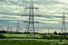 Power lines in the field Royalty Free Stock Photos