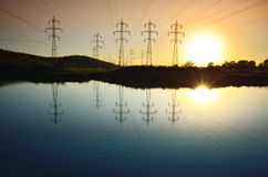 Power lines towers field  Royalty Free Stock Images