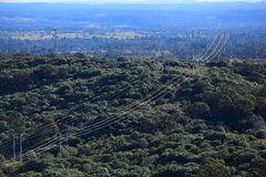 Power lines in forest landscape aerial view Stock Images