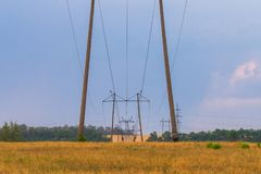 Power lines going into the distance across rural country.  Royalty Free Stock Images