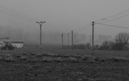 Power lines   in the haze Stock Photography