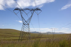 Power lines. High voltage power lines running through open grassland habitat, South Africa royalty free stock images