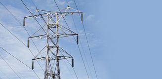 Power lines. High voltage tower with blue sky Stock Photos