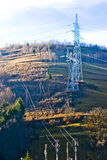 Power Lines on hill. Several electrical power lines crisscross this hillside as part of the country's power grid Royalty Free Stock Images