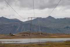 Power lines in Icelandic landscape Royalty Free Stock Photography