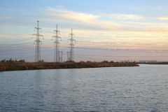 Power lines and lake. Royalty Free Stock Photo