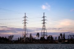 Power lines on the lake at sunset Royalty Free Stock Photography