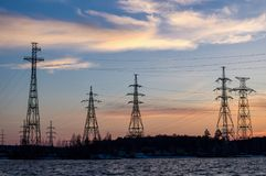 Power lines on the lake at sunset Stock Photography