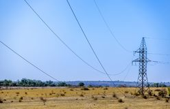 A power lines. Landscape with electricity pylon and power lines Stock Images