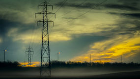 Power lines in the mist Stock Photography