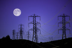 Power lines and moon Stock Photo
