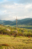 Power lines mountains. Electricity transmission in the mountain village. Power line. Power transmission. Royalty Free Stock Photography