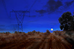 Power lines at night Stock Image