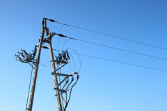 Power lines over blue sky Royalty Free Stock Photo