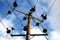 Power Lines Pole. A pole with power lines transporting electricity Royalty Free Stock Images