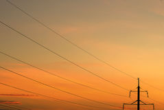 Power lines and pole. Power pole and lines in the evening at sunset Stock Images