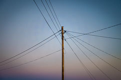 Power lines. On a pole of wood royalty free stock photos