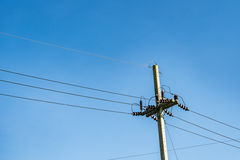 Power lines with pylon on blue sky Royalty Free Stock Images