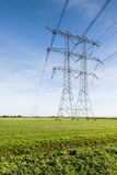 Power lines and pylons in a rural landscape Stock Photo