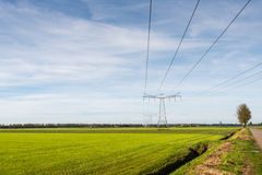 Power lines and pylons in a rural landscape Royalty Free Stock Photos