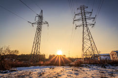 Power lines and rays of the sun. In winter, Poland Royalty Free Stock Photography