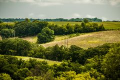 Power Lines Running Through A Lush Green Valley. Power lines run through the beautiful green rolling hills and valleys of Northeast Iowa royalty free stock photos