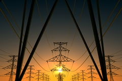 Power lines and setting sun. Stock Images