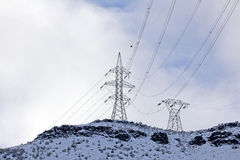 Power Lines on Snow Covered Hills Stock Photo