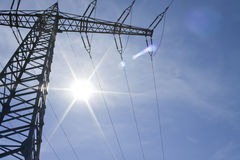 Power lines and solar  energy Royalty Free Stock Images