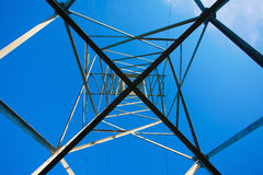 Power lines steel construction against blue sky Royalty Free Stock Images