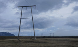 Power lines. Stretching across beautiful country side in Iceland Stock Photography