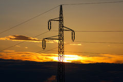 Power lines in sunrise Stock Images