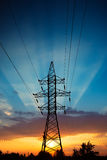 Power lines at sunrise Royalty Free Stock Image