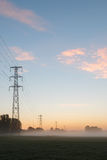 Power lines during sunrise Stock Image