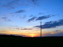 Power lines at sunset Royalty Free Stock Photography