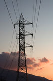 Power Lines At Sunset. With Distant Orange Clouds Royalty Free Stock Images