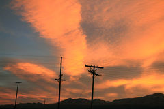 Power lines at sunset Stock Photos