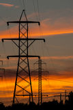 Power Lines at Sunset. Several powerlines silouetted against a sunset in King, North Carolina Stock Photos