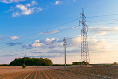 Power lines and telephone poles in the sunset Royalty Free Stock Photos