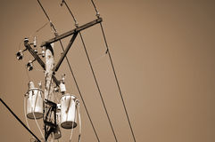Power lines and transformer - sepia. A sepia-toned image of power lines royalty free stock images