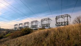 Power lines transmit electricity by wire, high voltage. Ukraine Zaporozhye royalty free stock photo