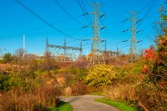 Power lines and walkway Stock Images