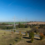 Power lines wind turbines Stock Image