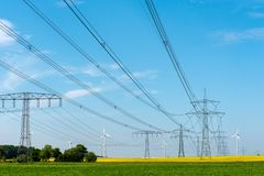Power lines and wind turbines. Seen in Germany royalty free stock photos