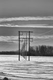 Power lines in winter. In black and white Royalty Free Stock Images