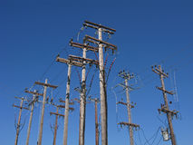 Power lines on wooden poles Royalty Free Stock Photos