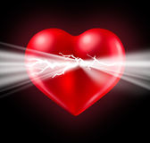 Power Of Love. Power of human love and Euphoria with intense feelings and the energy of romantic emotions emerging  and bursting from a glowing red heart shaped Royalty Free Stock Photography